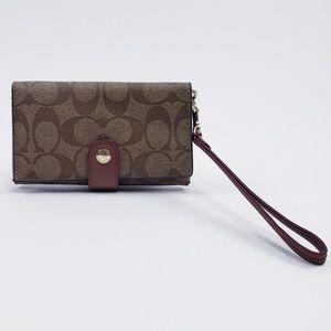 Signature Coach Wristlet wallet